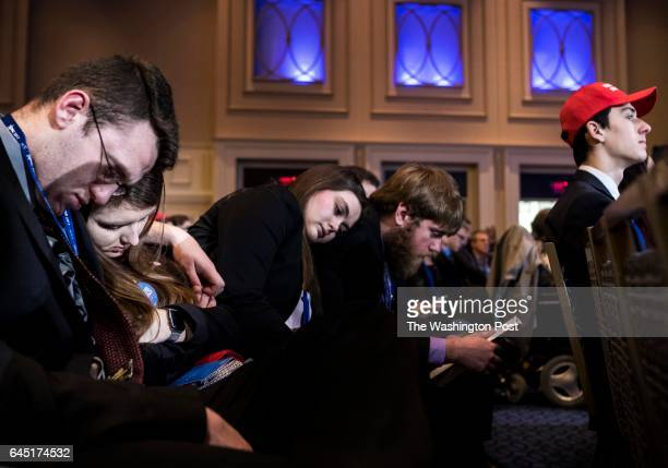 HILL MD Tired supporters wait for President Donald Trump to speak to a packed ballroom during the CPAC conference at the Gaylord Hotel and Convention...