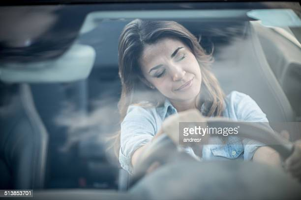Tired woman driving a car