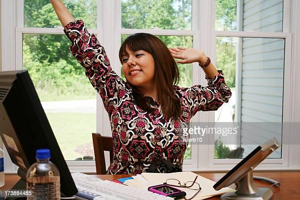 Tired Young Hispanic Woman At Work