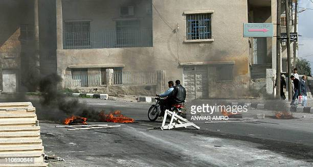 Tires burn during antigovernment protests on the streets of Daraa 100kms south of the capital Damascus on March 23 2011 Three people including an...