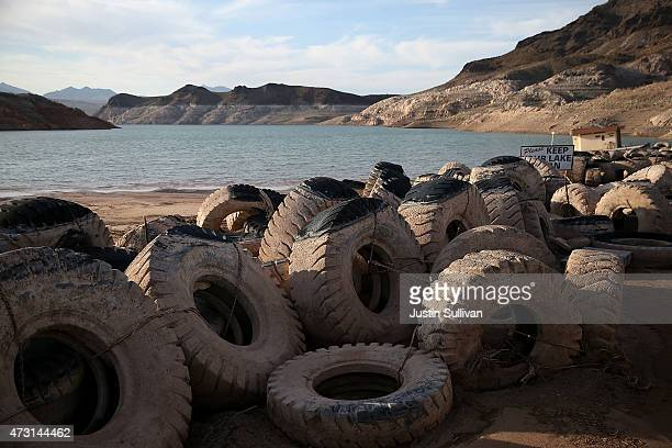 Tires once used as a breakwater sit on dry land at abandoned Echo Bay Marina on May 12 2015 in Lake Mead National Recreation Area Nevada As severe...