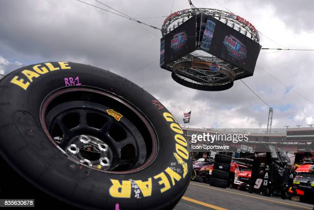 Tires sit on pit road under the Colossus TV screen during practice for the Food City 300 on August 17 at the Bristol Motor Speedway in Bristol...