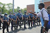Tirezz Walker a resident of Ferguson speaks to Missouri Highway Patrol offers in riot gear during a protest of the shooting death of 18yearold...
