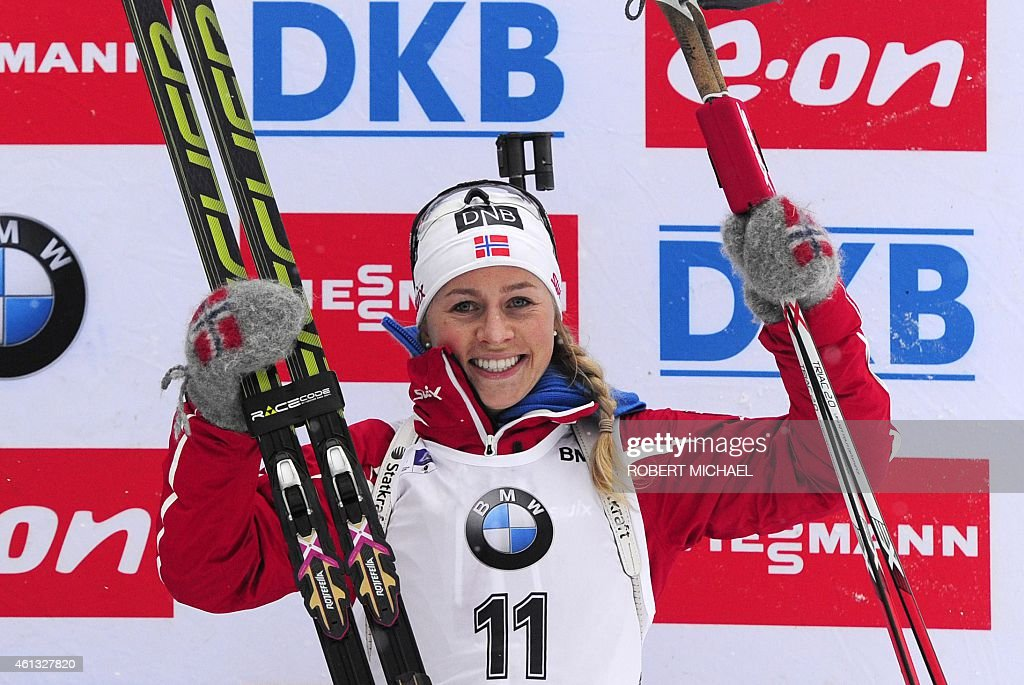 <a gi-track='captionPersonalityLinkClicked' href=/galleries/search?phrase=Tiril+Eckhoff&family=editorial&specificpeople=10023336 ng-click='$event.stopPropagation()'>Tiril Eckhoff</a> of Norway celebrates on the podium after placing third in the women's 12,5 km mass start event of the IBU biathlon World Cup in Oberhof, eastern Germany, on January 11, 2015. Darya Domracheva of Belarus won the race ahead of Veronika Vitkova of the Czech Republic (2nd) and <a gi-track='captionPersonalityLinkClicked' href=/galleries/search?phrase=Tiril+Eckhoff&family=editorial&specificpeople=10023336 ng-click='$event.stopPropagation()'>Tiril Eckhoff</a> of Norway (3rd). AFP PHOTO / ROBERT MICHAEL