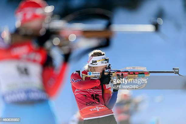 Tiril Eckhoff of Norway is zeroing prior to the women's 75 km sprint event during the IBU Biathlon World Cup in Pokljuka on December 18 2014 AFP...