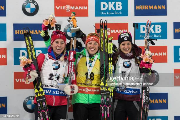 Tiril Eckhoff of Norway Laura Dahlmeier of Germany and Anais Chevalier of France celebrate after the 75 km women's Sprint on March 2 2017 in...
