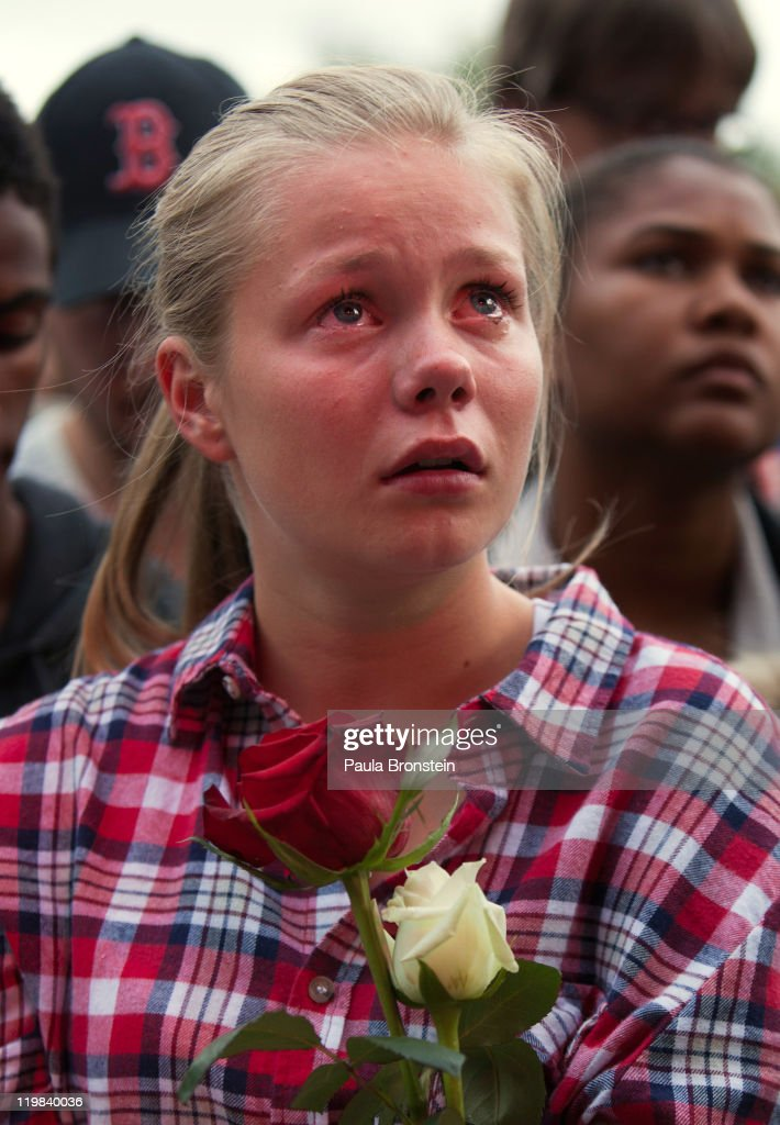 Tiril Killi, 16, cries as hundreds of thousands of people gather at a memorial vigil following Friday's twin extremist attacks, July 25, 2011 in Oslo, Norway. Anders Behring Breivik, 32, claimed that he has 'two more cells' working with him as he appeared in court today following a bomb blast at a government building in Oslo and a shooting massacre on nearby Utoya Island that killed at least 76 people in all. The death toll was originally reported as 93.