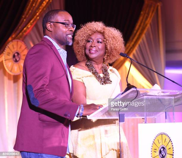Tirrell D Whittley and Kathleen Bertrand speak onstage at 2017 BronzeLens Women SuperStars Luncheon at Westin Peachtree Plaza on August 25 2017 in...