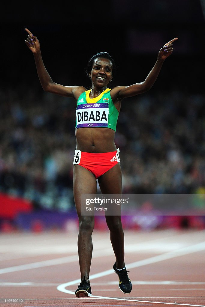 <a gi-track='captionPersonalityLinkClicked' href=/galleries/search?phrase=Tirunesh+Dibaba&family=editorial&specificpeople=233528 ng-click='$event.stopPropagation()'>Tirunesh Dibaba</a> of Ethiopia celebrates as she crosses the finish line in the Women's 10,000m Final on Day 7 of the London 2012 Olympic Games at Olympic Stadium on August 3, 2012 in London, England.