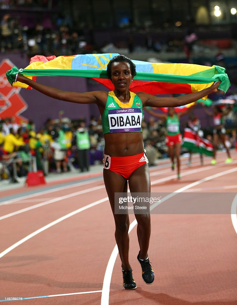 <a gi-track='captionPersonalityLinkClicked' href=/galleries/search?phrase=Tirunesh+Dibaba&family=editorial&specificpeople=233528 ng-click='$event.stopPropagation()'>Tirunesh Dibaba</a> of Ethiopia celebrates winning gold in the Women's 10,000m Final on Day 7 of the London 2012 Olympic Games at Olympic Stadium on August 3, 2012 in London, England.