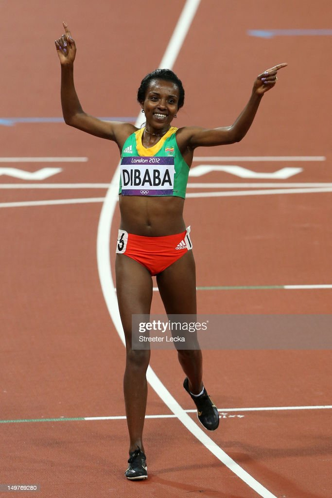 Tirunesh Dibaba of Ethiopia celebrates winning gold in the Women's 10,000m Final on Day 7 of the London 2012 Olympic Games at Olympic Stadium on August 3, 2012 in London, England.