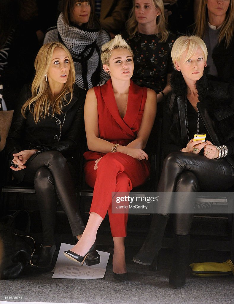 Tish Cyrus , <a gi-track='captionPersonalityLinkClicked' href=/galleries/search?phrase=Miley+Cyrus&family=editorial&specificpeople=3973523 ng-click='$event.stopPropagation()'>Miley Cyrus</a> and <a gi-track='captionPersonalityLinkClicked' href=/galleries/search?phrase=Joanna+Coles&family=editorial&specificpeople=4060670 ng-click='$event.stopPropagation()'>Joanna Coles</a>, editor-in-chief of Marie Claire magazine attend Rachel Zoe during Fall 2013 Mercedes-Benz Fashion Week at The Studio at Lincoln Center on February 13, 2013 in New York City.