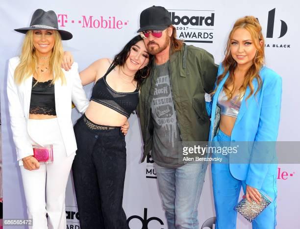 Tish Cyrus singers Billy Ray Cyrus and Noah Cyrus and DJ Brandi Cyrus arrive at 2017 Billboard Music Awards at TMobile Arena on May 21 2017 in Las...