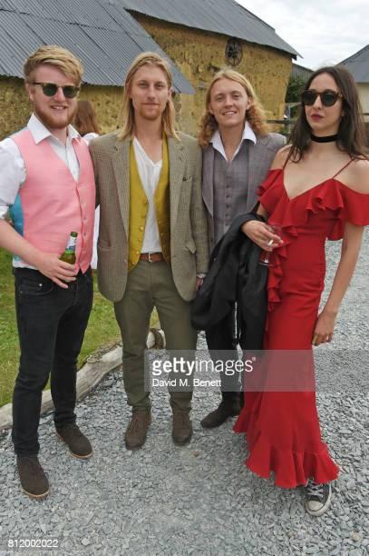 Tish Weinstock poses with Oscar Dunbar and band members at Greta Bellamacina and Robert Montgomery's wedding on July 8 2017 in Exeter England