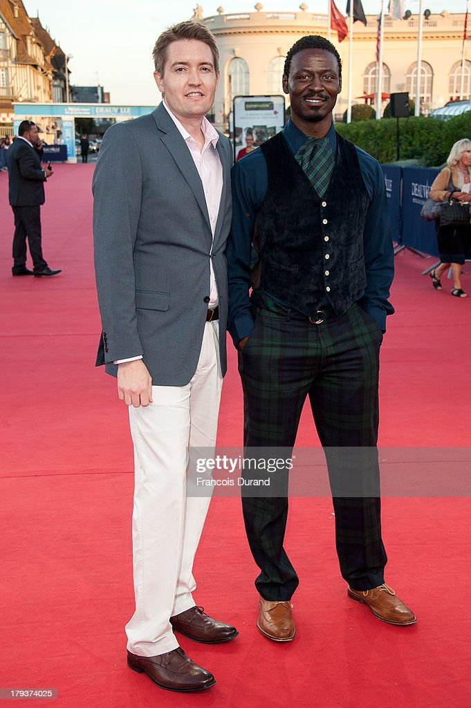 Tishuan Scott (R) and Chris Eska arrive at the premiere of the movie 'Joe' during the 39th Deauville American film festival on September 2, 2013 in Deauville, France.