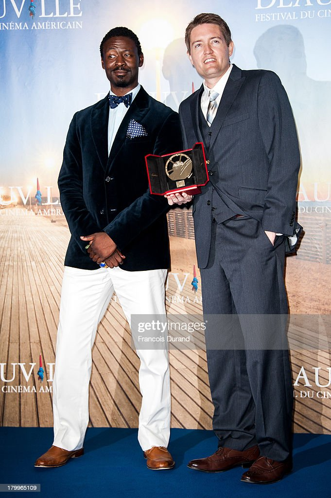 Tishuan Scott (L) and Chris Eska pose with their prize for the film 'The retrieval' during the 39th Deauville American Film Festival on September 7, 2013 in Deauville, France.