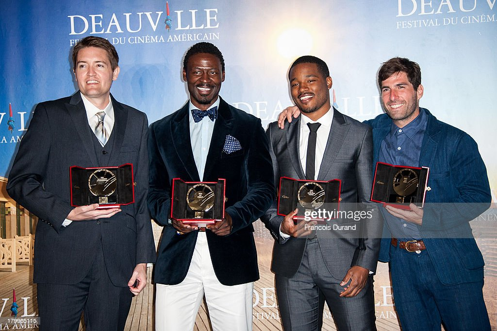 Tishuan Scott, Chris Eska, <a gi-track='captionPersonalityLinkClicked' href=/galleries/search?phrase=Ryan+Coogler&family=editorial&specificpeople=7316581 ng-click='$event.stopPropagation()'>Ryan Coogler</a> and Sam Fleischner pose with their prize at the award photocall during the 39th Deauville American Film Festival on September 7, 2013 in Deauville, France.