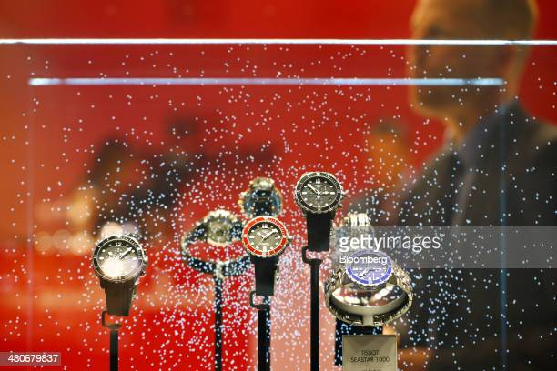 Tissot Seastar 1000 wristwatches produced by Tissot a unit of Swatch Group AG sit on display at the company's booth during the Baselworld luxury...
