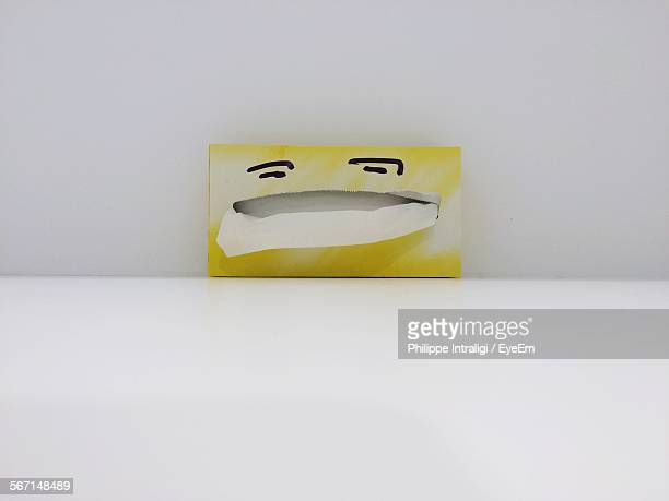 Tissue Box On Table Against Wall