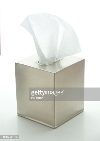 Tissue box with tissues on white