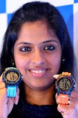 A Titan employee poses for photographs during the launch of Sonata's SF range of Slide Touch adventure series watches in Bangalore on August 24 2015...
