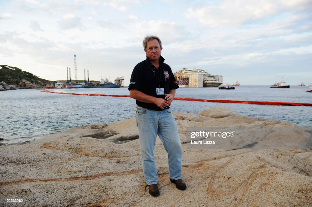 Titan Senior Salvage Master Nick Sloane poses a few hours before the maneuvers and departure of the ship form the island on July 22, 2014 in Isola del Giglio, Italy. Technicians are preparing to start towing the ship to the port of Genoa for dismantling on Wednesday, July 23.