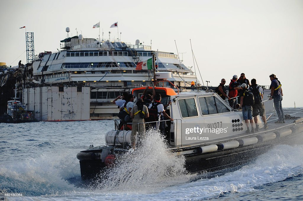 Titan-Micoperi workers make their way out to the wrecked ship Costa Concordia before the start of the refloating operations on July 14, 2014 in Isola del Giglio, Italy. On the first day of the operation the wreck will be partially refloated by 2 metres from the platfoms that support it and will then be moved approximately 30 metres to the east. The wreck will be held in position by tugs and moored by anchors with steel cables. The refloating operation is expected to take up to a week before the wreck is towed to the port of Genoa for dismantling.