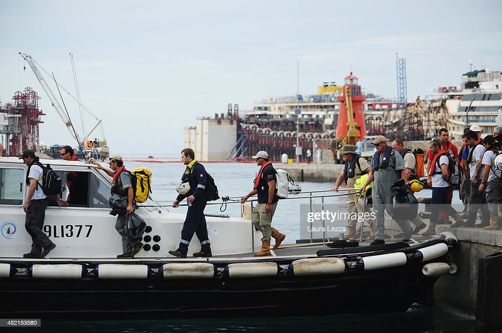Titan-Micoperi workers make their way out to the wrecked ship Costa Concordia after the refloating operations on July 14, 2014 in Isola del Giglio, Italy. On the first day of the operation the wreck will be partially refloated by 2 metres from the platfoms that support it and will be moved approximately 30 metres to the east. The wreck will then be kept in position by tugs and moored by anchors aft, with steel cables. The refloating operation is expected to take up to a week before being towed to the port of Genoa for dismantling.