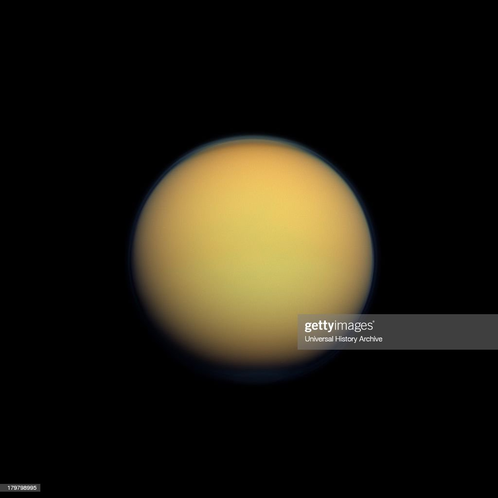 Titan's atmosphere makes Saturn's largest moon look like a fuzzy orange ball in this natural color view from the Cassini spacecraft Titan