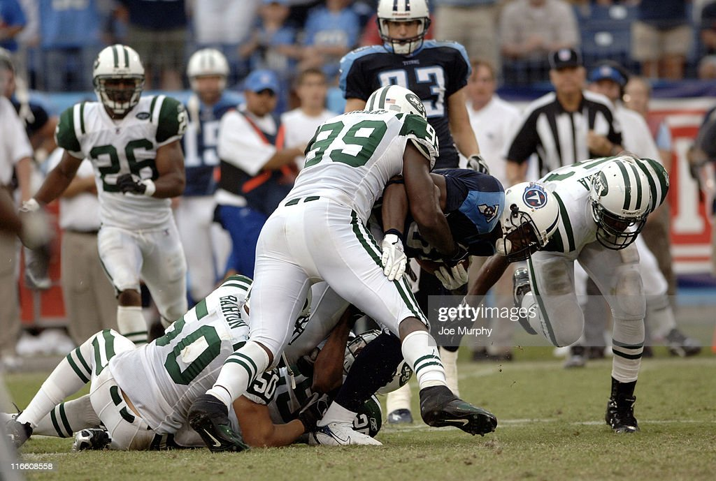 Titans Ben Troupe is tackled by Jets Eric Barton and Bryan Thomas during second half action as the New York Jets beat the Tennessee Titans 2316 on...