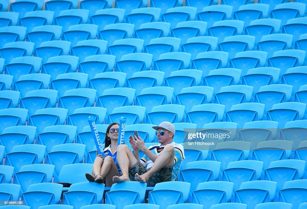 Titans fans sit in the grandstand during the round nine NRL match between the Gold Coast Titans and the Newcastle Knights at Cbus Super Stadium on April 29, 2017 in Gold Coast, Australia.