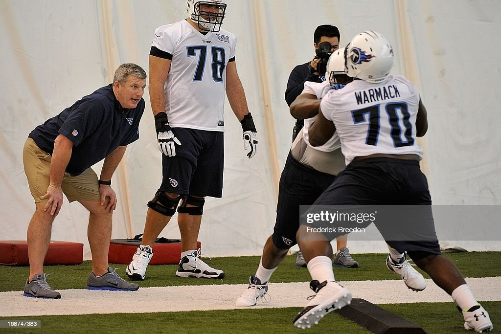 Titans head coach Mike Munchak watches first round pick Chance Warmack #70 at the Tennessee Titans rookie camp on May 10, 2013 in Nashville, Tennessee.