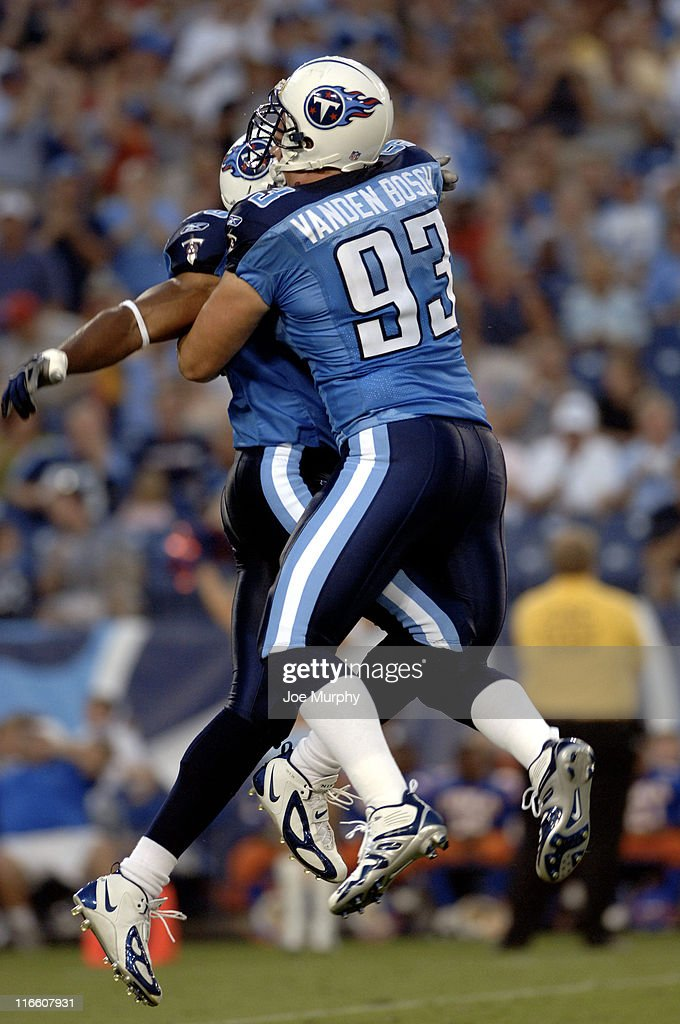 Titans Kyle Vanden Bosch #93 and David Thornton #50 celebrate after a sack during first half action between the Atlanta Falcons and the Tennessee Titans on August 26, 2006 at The Coliseum in Nashville, Tennessee.