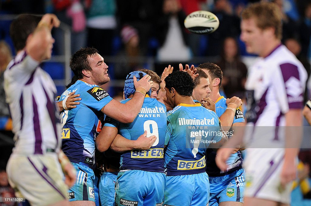 Titans players celebrate a try during the round 15 NRL match between the Gold Coast Titans and the Melbourne Storm at Skilled Park on June 24, 2013 on the Gold Coast, Australia.