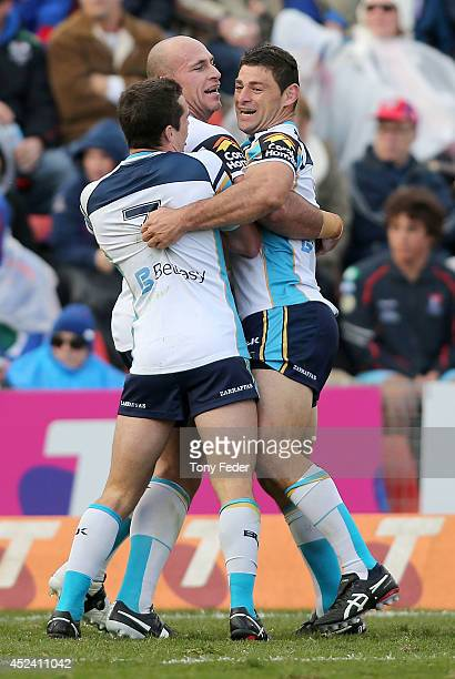 Titans players celebrate a try during the round 19 NRL match between the Newcastle Knights and Gold Coast Titans at Hunter Stadium on July 20 2014 in...