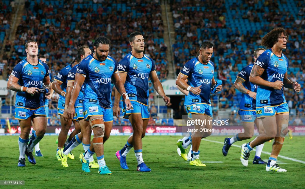Titans players leave the field dejected at halftime during the round one NRL match between the Gold Coast Titans and the Sydney Roosters at Cbus Super Stadium on March 4, 2017 in Gold Coast, Australia.