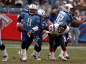 Titans Steve McNair is forced from the pocket by Texans Jason Babin The Tennessee Titans beat the Houston Texans 1310 at The Coliseum in Nashville TN...