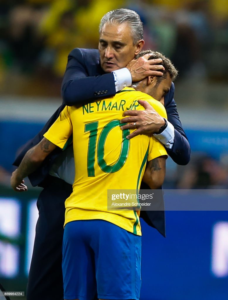 Tite, head coach of Brazil gives a hug to Neymar during the match between Brazil and Chile for the 2018 FIFA World Cup Russia Qualifier at Allianz Parque Stadium on October 10, 2017 in Sao Paulo, Brazil.