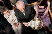 Tithes and offering during a church service.