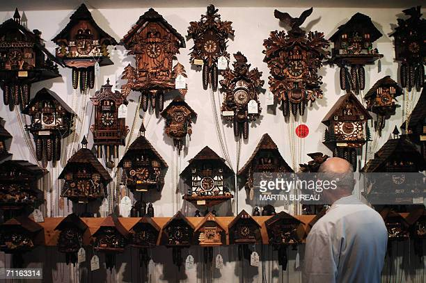 A man looks at cuckoo clocks 09 June 2006 in a shop of TitiseeNeustadt AFP PHOTO MARTIN BUREAU