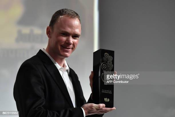 Title holder Britain's Chris Froome holds a trophy during the presentation of the official route of the 2018 edition of the Tour de France cycling...