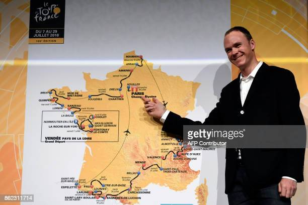 Title holder Britain's Chris Froome poses in front of a map of the official route of the 2018 edition of the Tour de France cycling race during its...