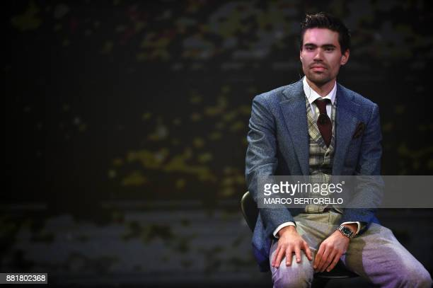 Title holder Tom Dumoulin of Netherlands looks on during the presentation of the 2018 Tour of Italy cycling race on November 29 2017 in Milan / AFP...