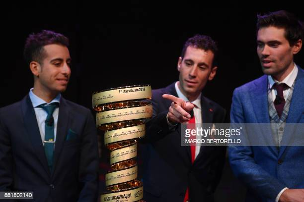 Title holder Tom Dumoulin of Netherlands poses next to Italian riders Fabio Aru and Vincenzo Nibali with the trophy of the Giro d'Italia during the...