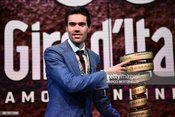 Title holder Tom Dumoulin of Netherlands poses with the trophy of the Giro d'Italia during the presentation of the 2018 Tour of Italy cycling race on...