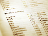 Cropped shot of the title page of a copy of the Holy Bible, showing the books of the New Testament.