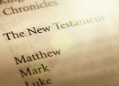 A Bible is open to the title page and shows the books of the New Testament.