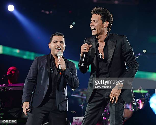 Tito El Bambino and Marc Anthony perform at American Airlines Arena on October 3 2014 in Miami Florida