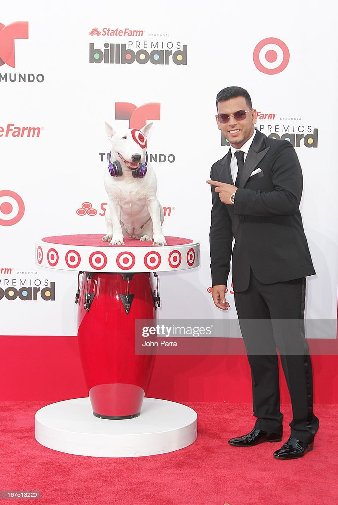 Tito El Bambino celebrates with Bullseye, Target's Beloved Bull Terrier Mascot, at the 2013 Billboard Latin Music Awards at BankUnited Center on April 25, 2013 in Miami, Florida.
