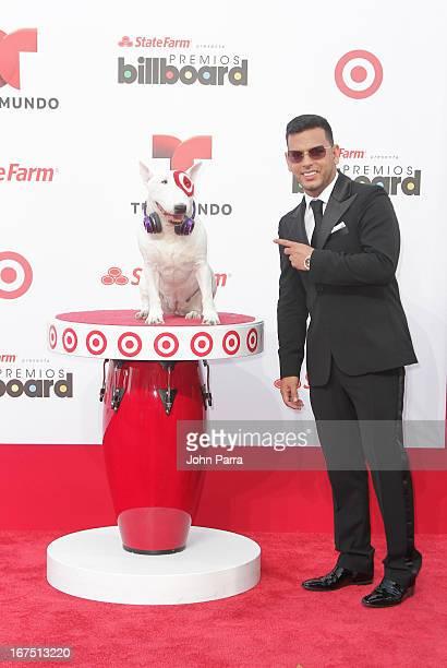 Tito El Bambino celebrates with Bullseye Target's Beloved Bull Terrier Mascot at the 2013 Billboard Latin Music Awards at BankUnited Center on April...